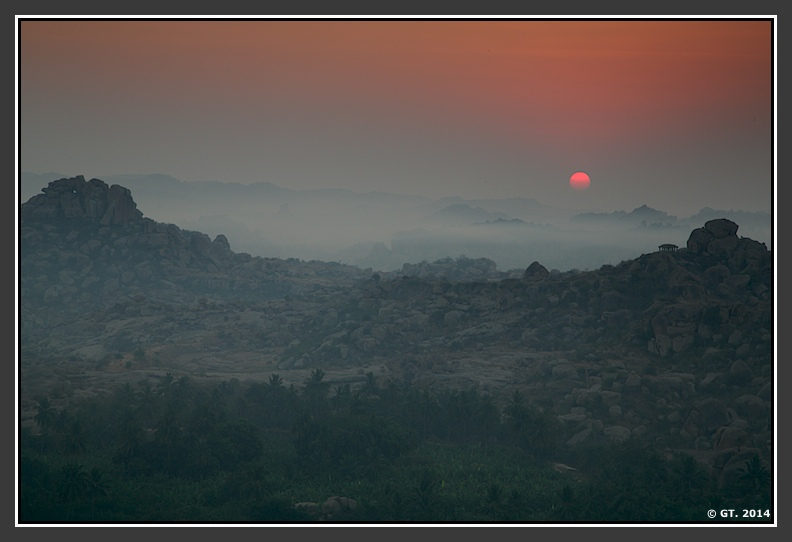 The main event begins… Sun rises over the numerous hillocks and brings various and brilliant hues of red, orange and yellow.